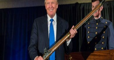 CHARLESTON, SC - FEBRUARY 22: Reality TV host and New York real estate mogul Donald Trump holds up a replica flintlock rifle awarded him by cadets during the Republican Society Patriot Dinner at the Citadel Military College on February 22, 2015 in Charleston, South Carolina. Trump and U.S. Sen. Tim Scott (R-SC) were honored at the annual event.  (Photo by Richard Ellis/Getty Images)