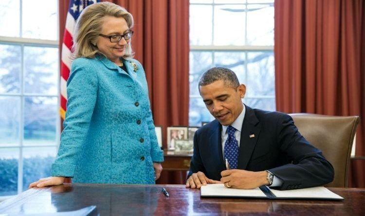President Barack Obama, with outgoing Secretary of State Hillary Rodham Clinton, signs a Presidential Memorandum in the Oval Office, Jan. 30, 2012. (Official White House Photo by Pete Souza)